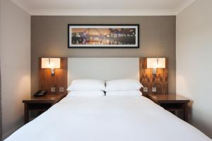 A bed or beds in a room at Doubletree By Hilton Glasgow Strathclyde
