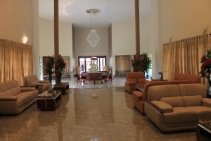 The lounge or bar area at Hotel Moon Palace Kolwezi