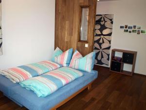 Postel nebo postele na pokoji v ubytování Appartement-Robin