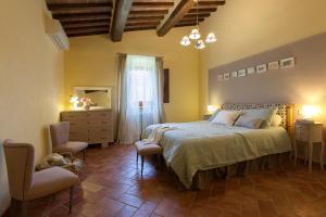 Letto o letti in una camera di Allegro Agriturismo Argiano