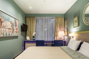 Кровать или кровати в номере Отель Брайтон