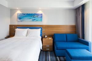 A bed or beds in a room at Hampton by Hilton Istanbul Kurtkoy