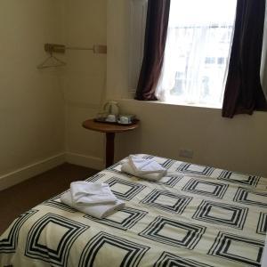 Un ou plusieurs lits dans un hébergement de l'établissement Central London Budget Hotel