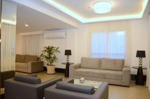 The lounge or bar area at Saionara Hotel