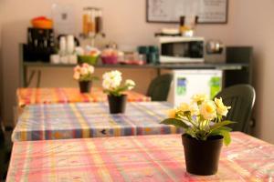 Restaurant ou autre lieu de restauration dans l'établissement Hello Roma B&B