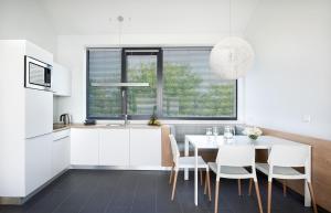 A kitchen or kitchenette at Boulevard Ustronie Morskie by Zdrojowa
