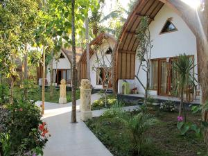 A porch or other outdoor area at Coco Resort Penida
