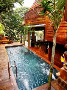 The swimming pool at or near Seven Senses Guesthouse