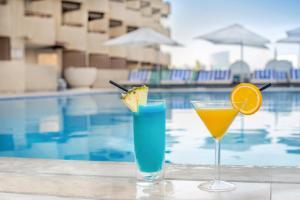 The swimming pool at or near Radisson Blu Hotel, Dubai Deira Creek
