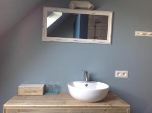 Ein Badezimmer in der Unterkunft Kokkelikoo