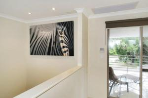 A balcony or terrace at Seal 4 Bedroom House by Shoalwater Executive Homes