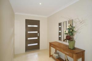 A seating area at Seal 4 Bedroom House by Shoalwater Executive Homes