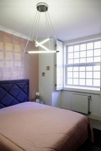 Een kamer bij Infante Apartment