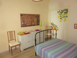 A bed or beds in a room at Tra Amalfi, Pompei, Paestum