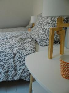 A bed or beds in a room at Les Viviers Maison d'hôtes B&B