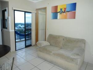 A seating area at Flat Apart-Hotel em Goiânia