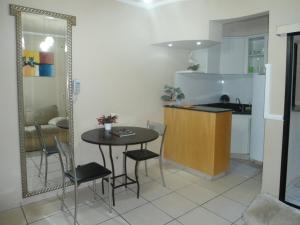 A kitchen or kitchenette at Flat Apart-Hotel em Goiânia