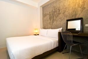 Een bed of bedden in een kamer bij The Album Hotel