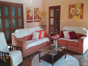 O lounge ou bar de Casa das Palmeiras + Quiosque