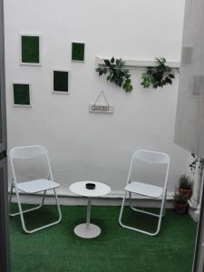 A seating area at Pension Travesía - Apartamento