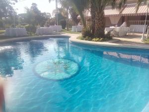 The swimming pool at or near Casa Los jardines de Lola