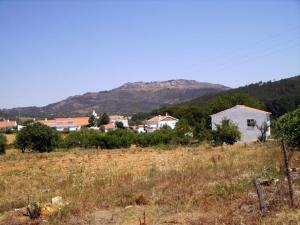 The surrounding neighborhood or a neighborhood close to the country house