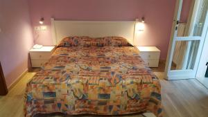 A bed or beds in a room at Hotel Villa Etrusca