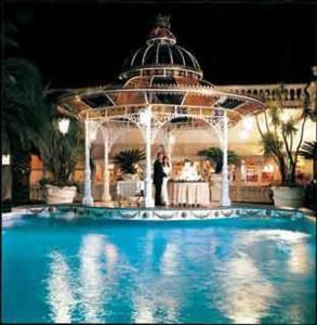 The swimming pool at or near Grand Hotel La Sonrisa