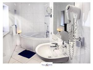 Koupelna v ubytování Hotel Villa Conti