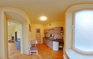 A kitchen or kitchenette at Apartamenty Marco - Stare Miasto