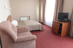Кровать или кровати в номере Атрон-Отель