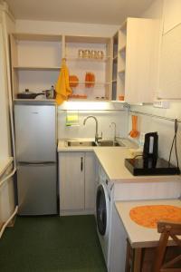 Кухня или мини-кухня в Asti Hotel