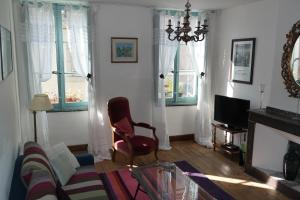 A seating area at The Apartments, Rue Barbès