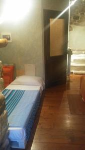 A bed or beds in a room at B&B Da Marta