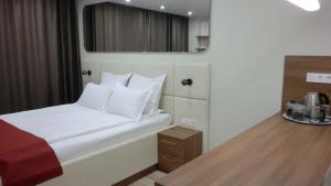 Кровать или кровати в номере Апартаменты Salt City Moscow
