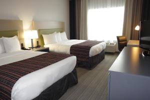 A room at Country Inn & Suites by Radisson, Coralville, IA
