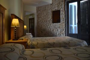 A bed or beds in a room at Casa Cundaro