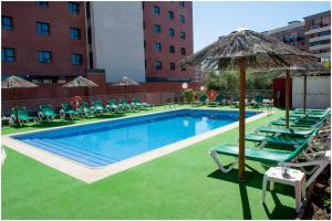 The swimming pool at or near Extremadura Hotel