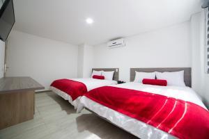 Cama o camas de una habitación en HOTEL MED 70