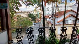 Uma varanda ou terraço em Chale Mineiro Hostel & Pousada