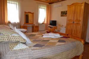 Кровать или кровати в номере Отель Алексеевская Усадьба
