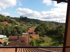 Uma varanda ou terraço em Apto Aconchegante na Serra Gaúcha