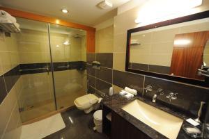 A bathroom at Suhim Portico Hotel