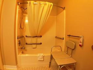 A bathroom at Super 8 by Wyndham Canandaigua
