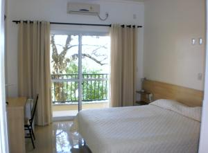 A bed or beds in a room at Estrela Palace Hotel