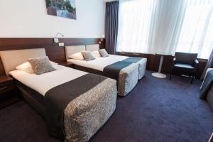 Cama o camas de una habitación en Hotel City Garden Amsterdam