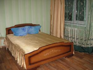 Кровать или кровати в номере Apartments at Lomonosova 7