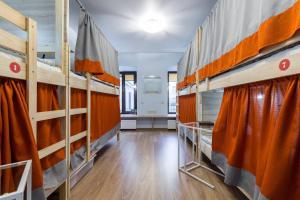 A bunk bed or bunk beds in a room at Like Hostel Sankt-Peterburg na Teatralnoy