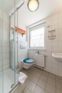 Ein Badezimmer in der Unterkunft Hörners Landgasthof