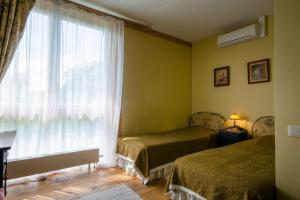 A bed or beds in a room at Marcienas Muiza & SPA